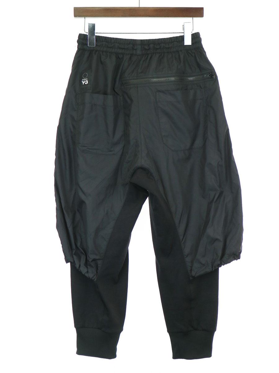 M NYLON MIX TRACK PANTS レイヤードナイロンミックストラックパンツ
